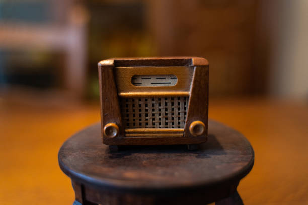 Old doll radio stands on a small doll table stock photo