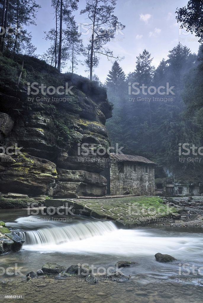 Old Dolsky mill with Kamenice river royalty-free stock photo