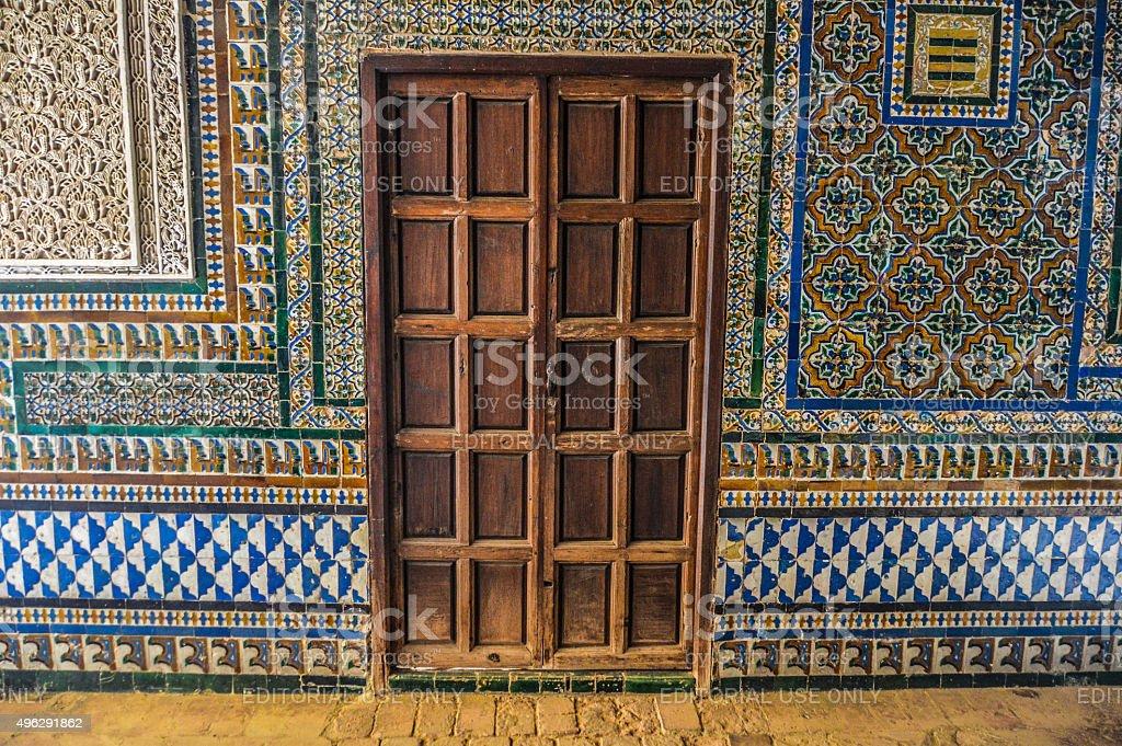Old door and exquisite tile work stock photo