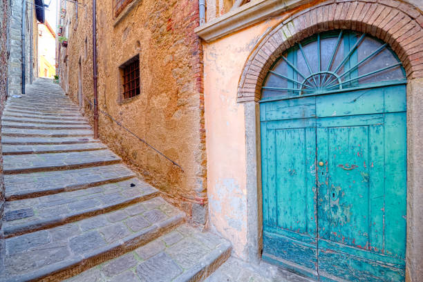 Old door and stairs of the medieval town of Cortona, Tuscany stock photo