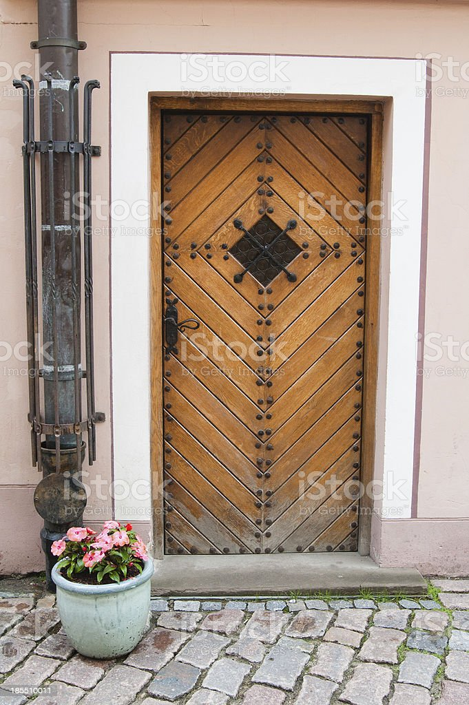 Old door and vase with flowers royalty-free stock photo