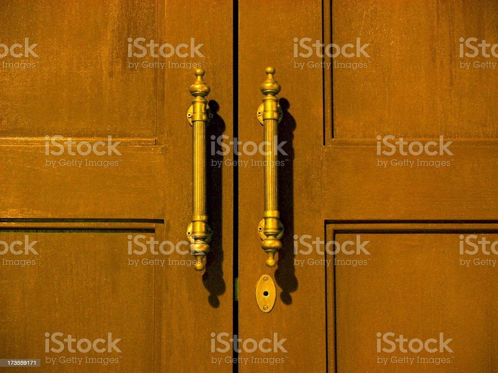 Painting-like wooden door and handles.