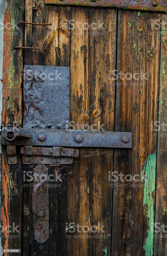 old door from a tree with the iron lock stock photo