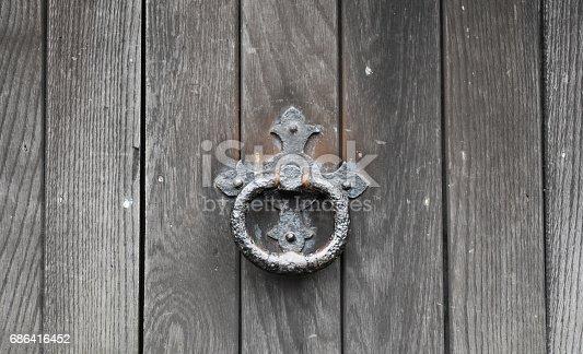 old wooden church door with Iron door knocker
