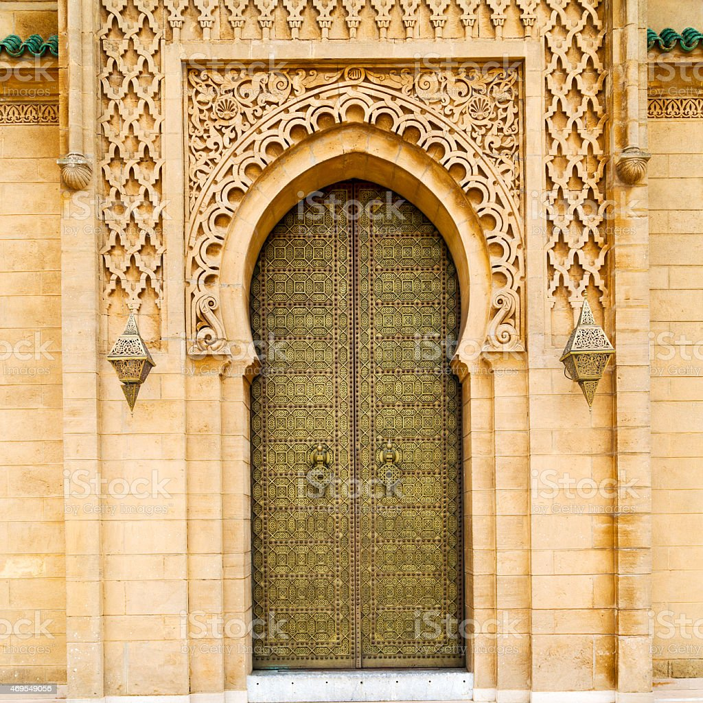 old door in morocco africa ancien and wall ornate brown stock photo
