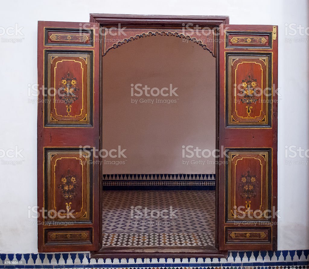 Old door in the Bahia Palace of Marrakech royalty-free stock photo