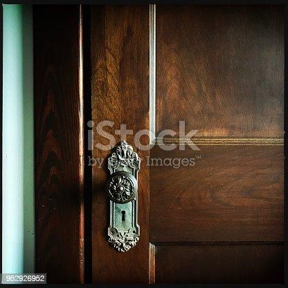 Old door  knob and wooden door.  iPhone