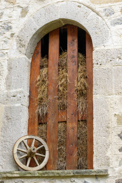Old door of a house in Oneta, Bergamo, Italy. stock photo
