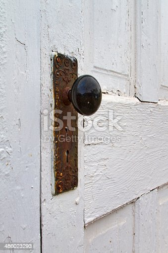 An old white door & doorknob from the 1800's