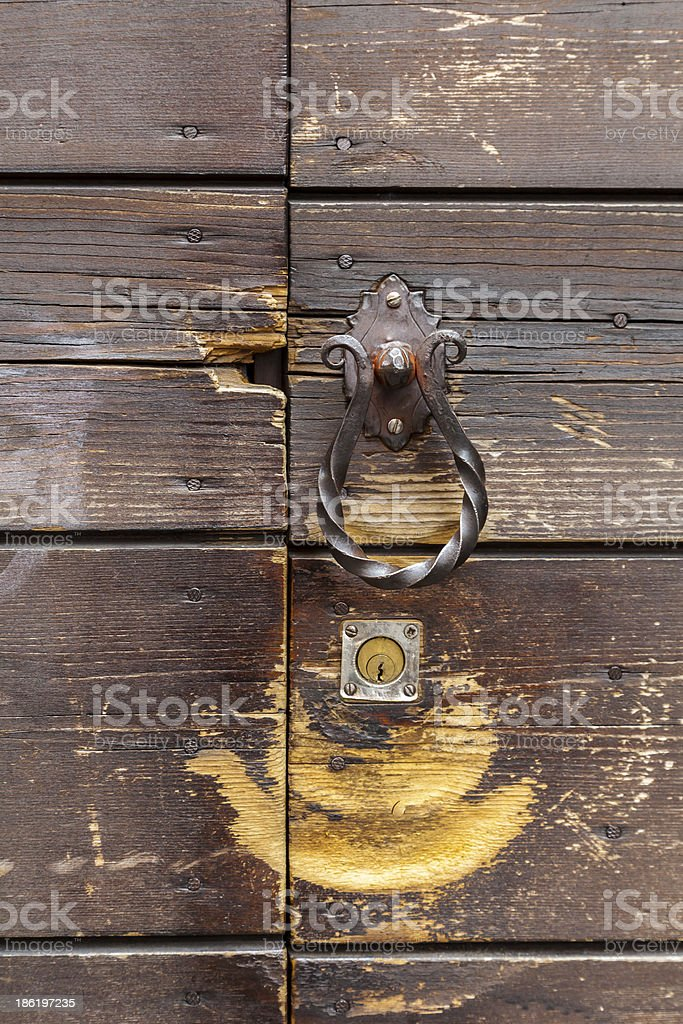Old door with decorative nails. royalty-free stock photo