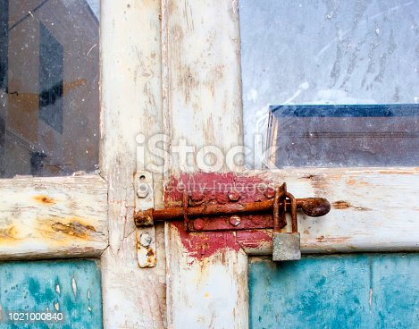 1178501072istockphoto Old Door with latch and padlock 1021000840