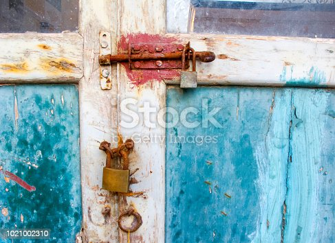1178501072istockphoto Old Door with latch and padlock 1021002310