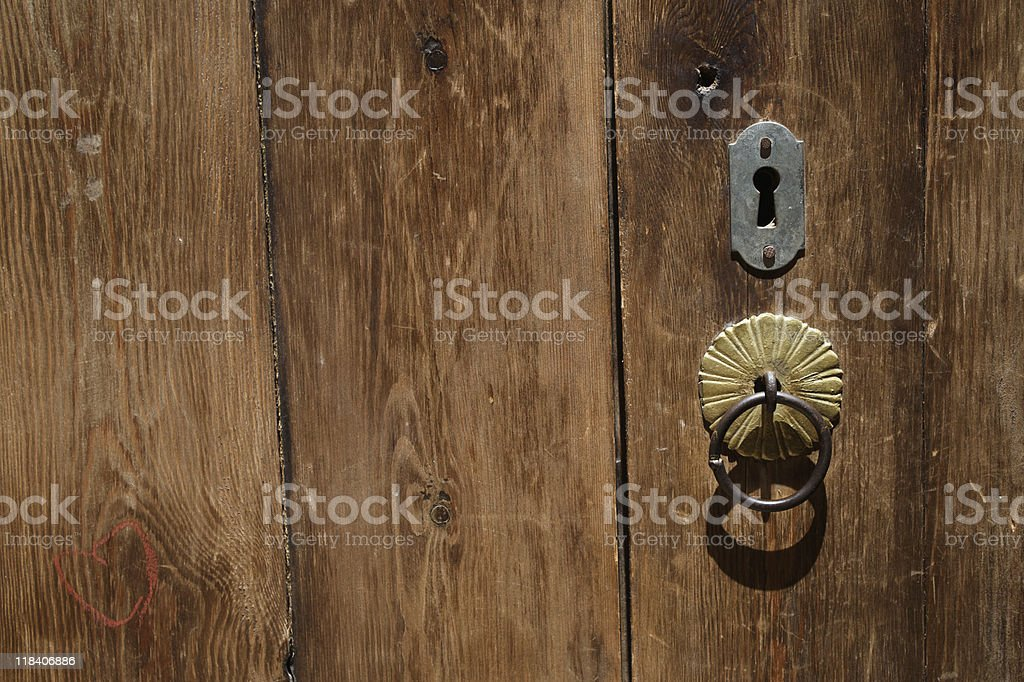 Old door with lock and door-knocker royalty-free stock photo