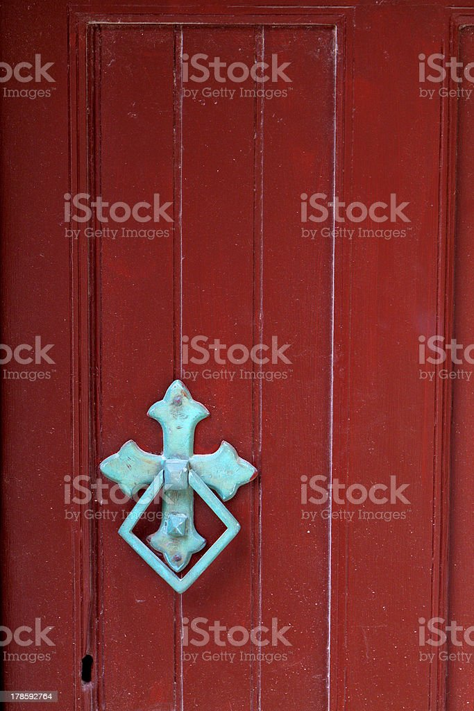 Old door with traditional knocker in Greece stock photo
