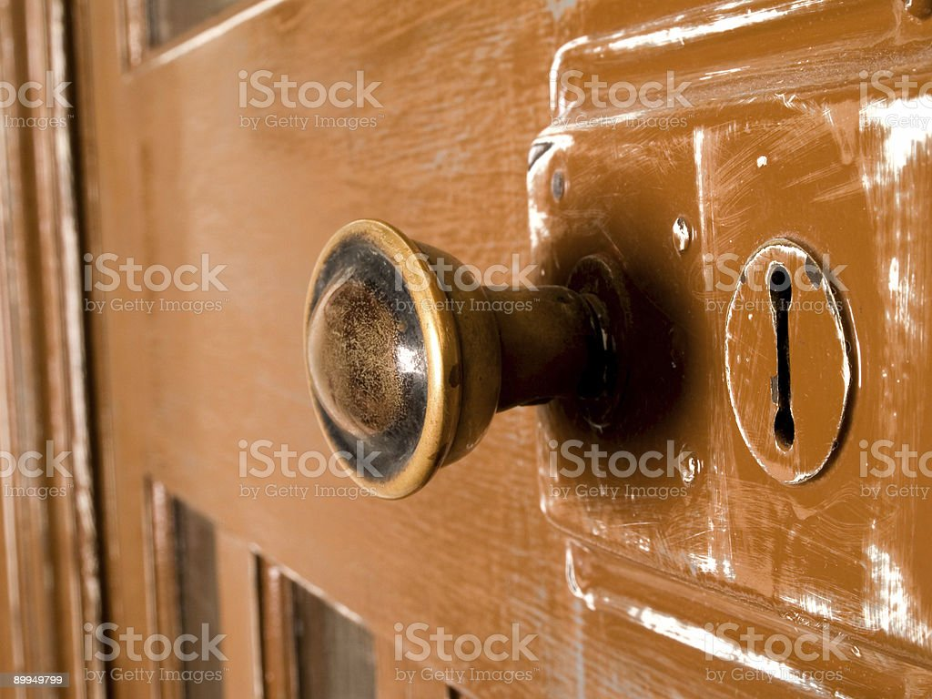 Old doorknob and keyhole. stock photo