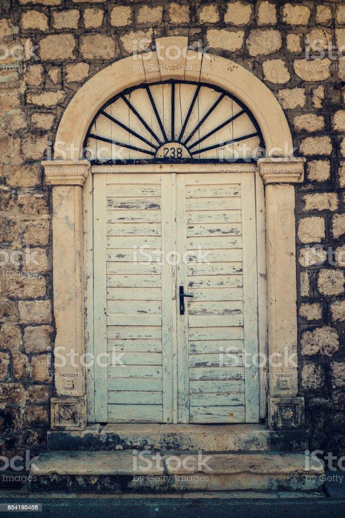 Old doors in Dobrota stock photo