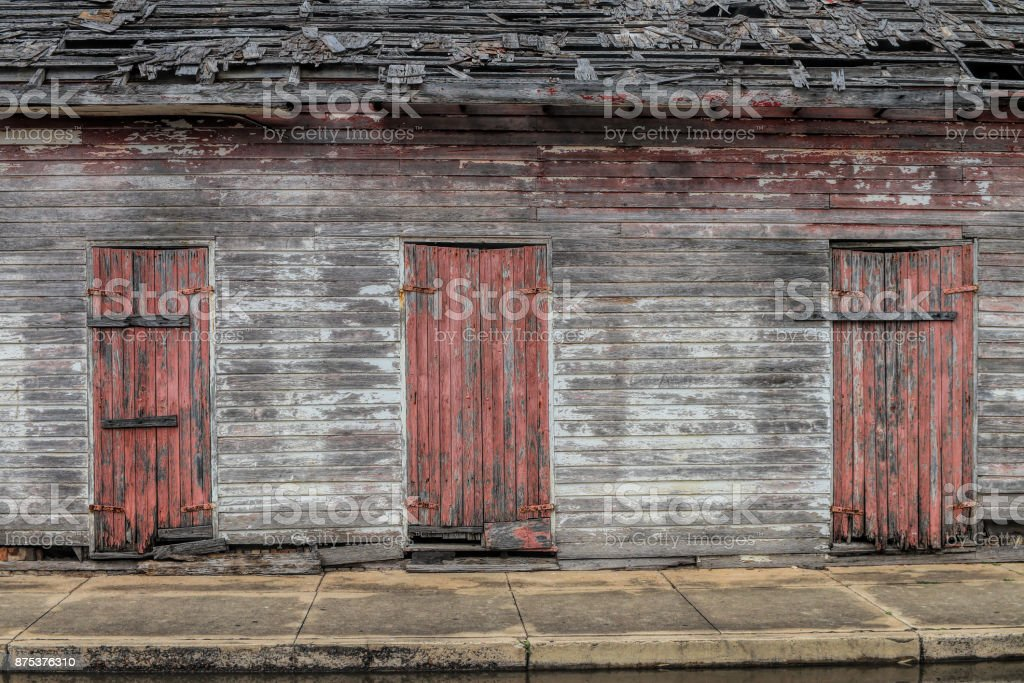 3 old doors on an old building stock photo