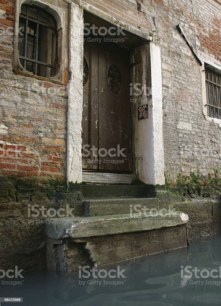 Old doorway in one of the Canals, Venice, Italy royalty-free stock photo