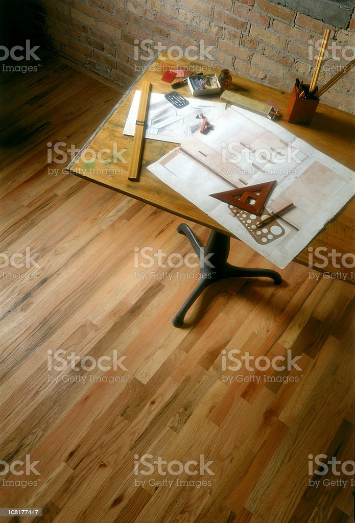 Old Drafting Table with Plans and Supplies stock photo