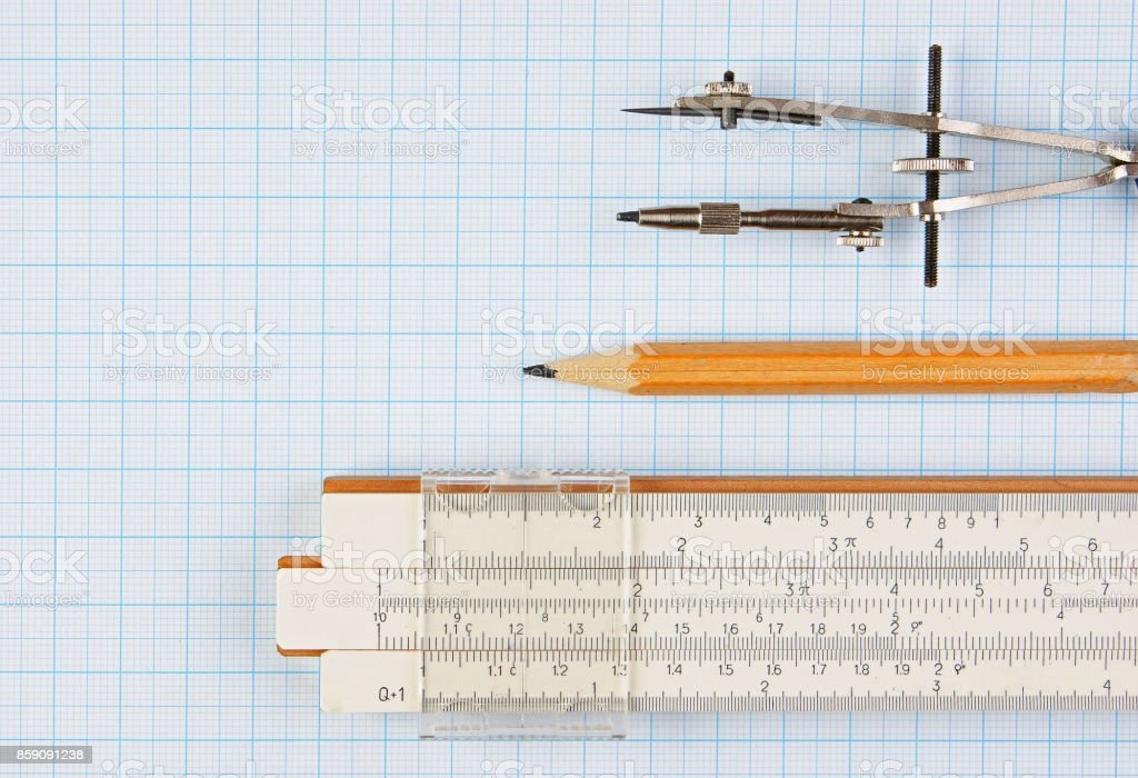 Old drawing tools on graph paper stock photo