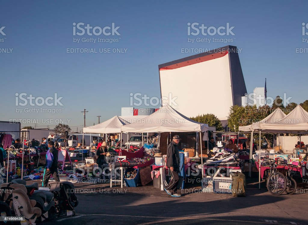Old drive-In theater turned flea market/swap meet with many vendors displaying goods. stock photo