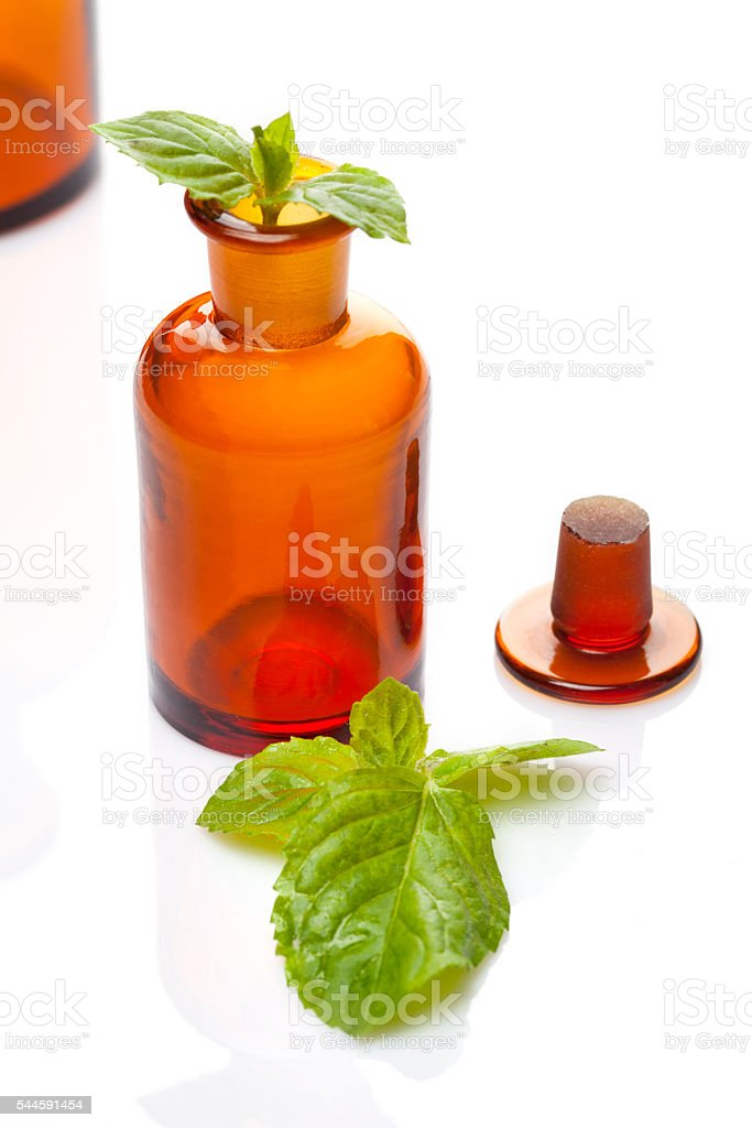 Old drugstore bottle and mint leaf stock photo