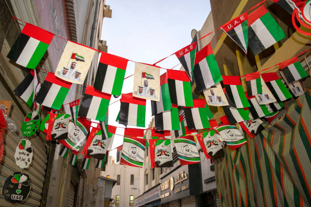 Old Dubai street with flags for Emirates National Day stock photo