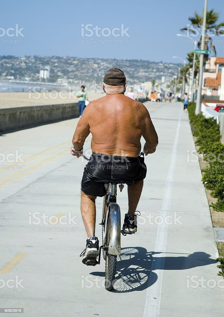 Old dude cruising on mission beach royalty-free stock photo