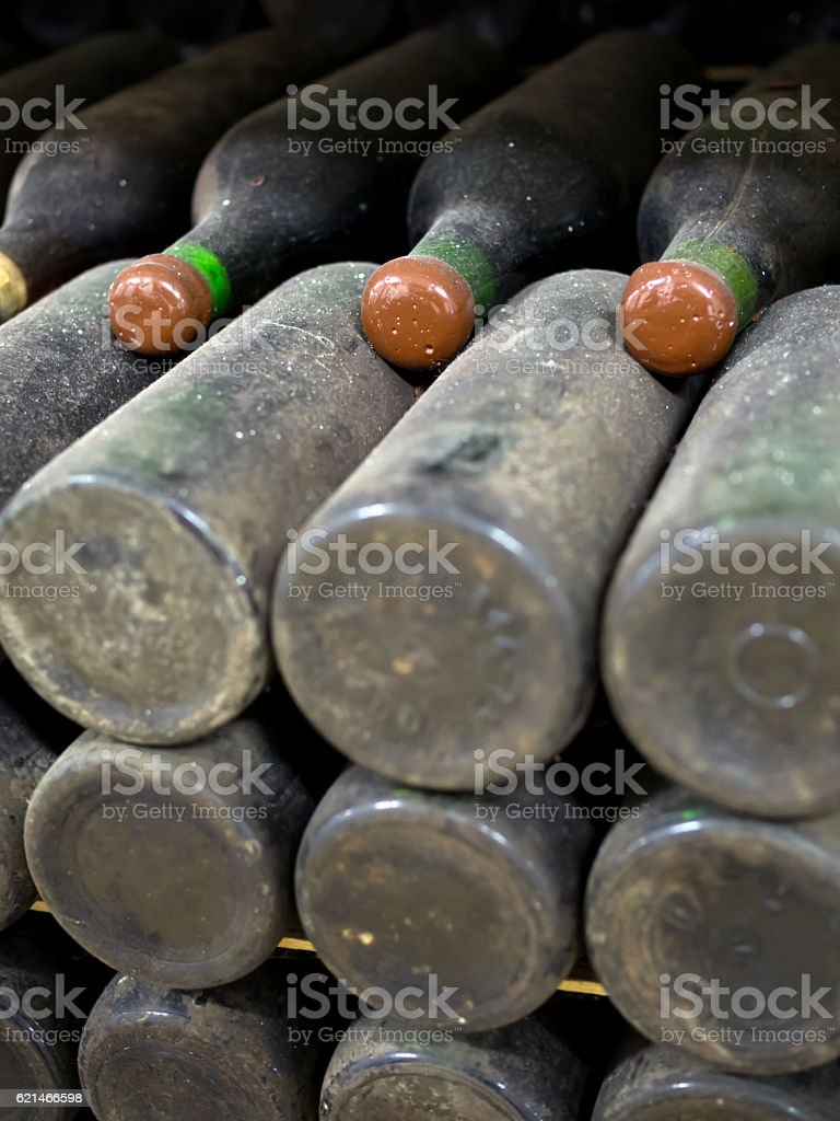 Old dusty bottles of wine mellow stock photo