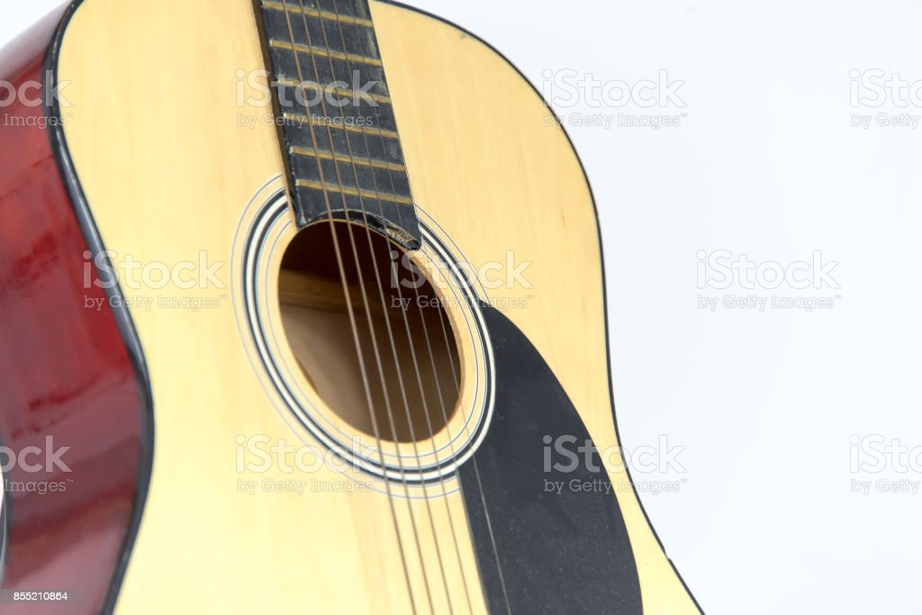 Old, dusty guitar shot on isolated white background. stock photo