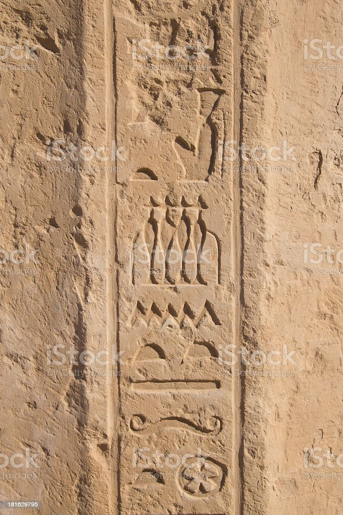 Old egypt hieroglyphs carved on the stone royalty-free stock photo