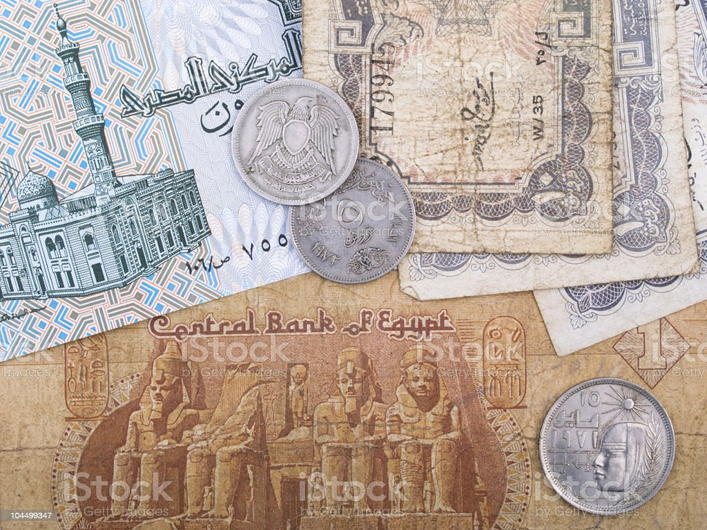 Old Egyptian banknotes and coins stock photo