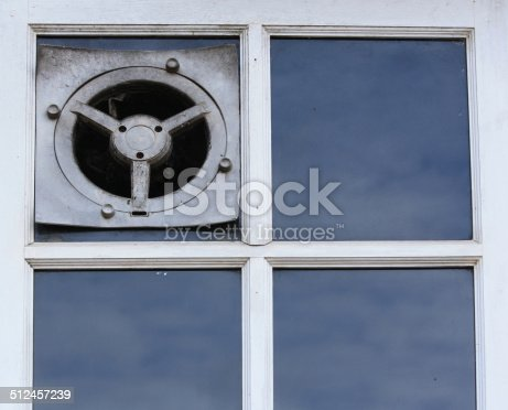 istock old electric air fan or the ventilator on a window 512457239