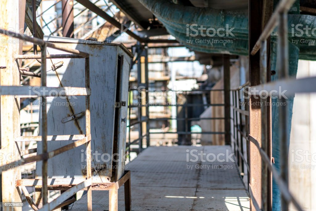 old electric box and aisle in an abandoned factory stock photo