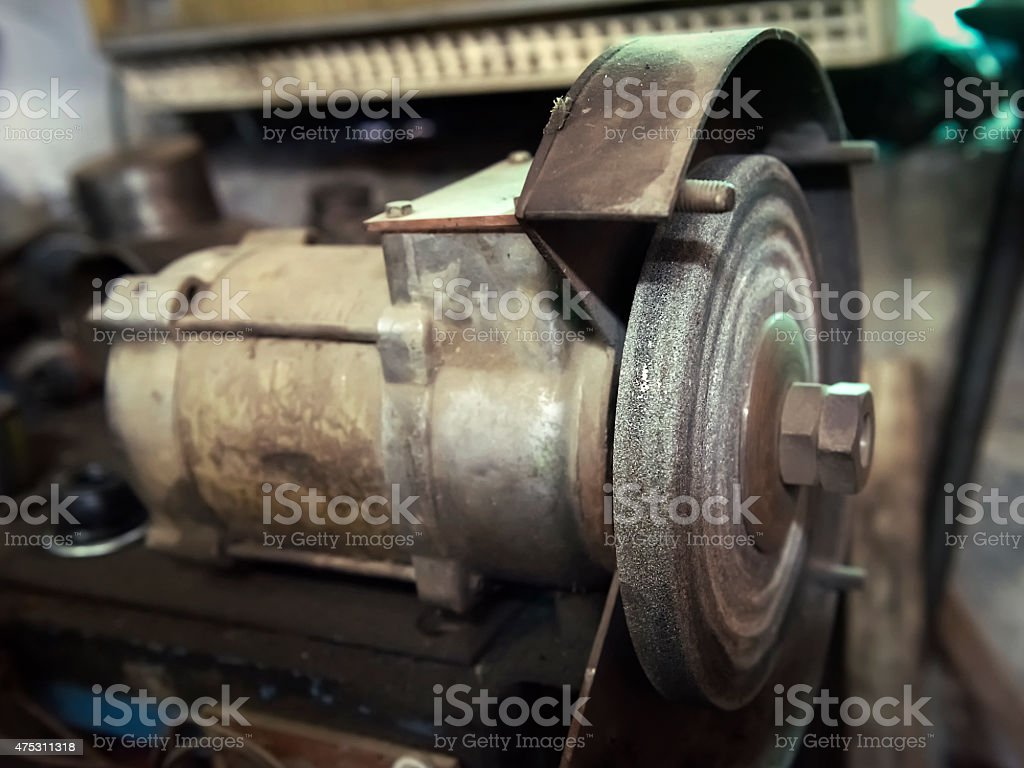 old electric grindstone closeup stock photo