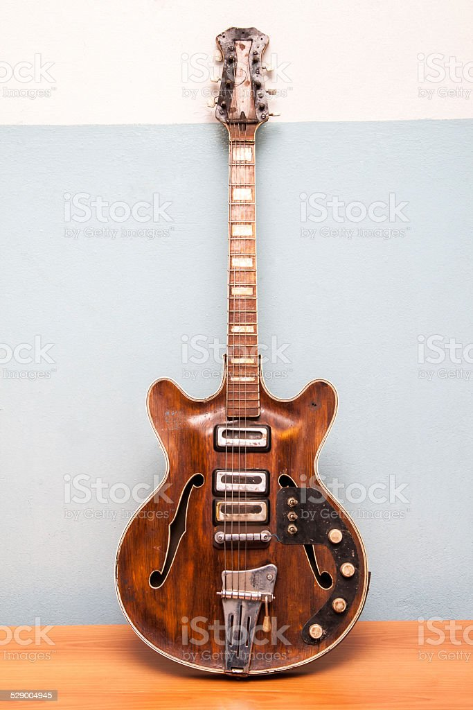 Old electric guitar stock photo