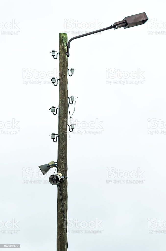 Old Electric Lamp Post With Cut Off Wires And Speakers Stock Photo ...