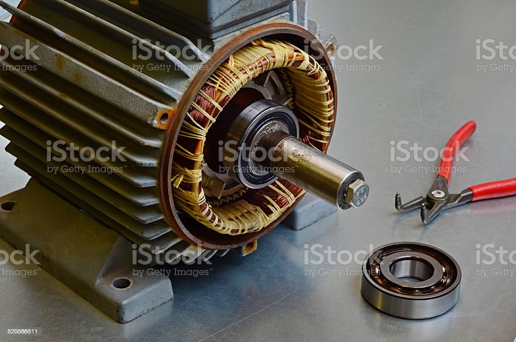 Old electric motor needs maintenance stock photo