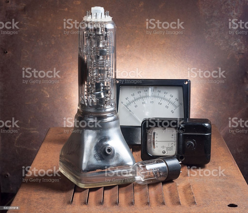 Old electrical appliances on a rusty chair stock photo
