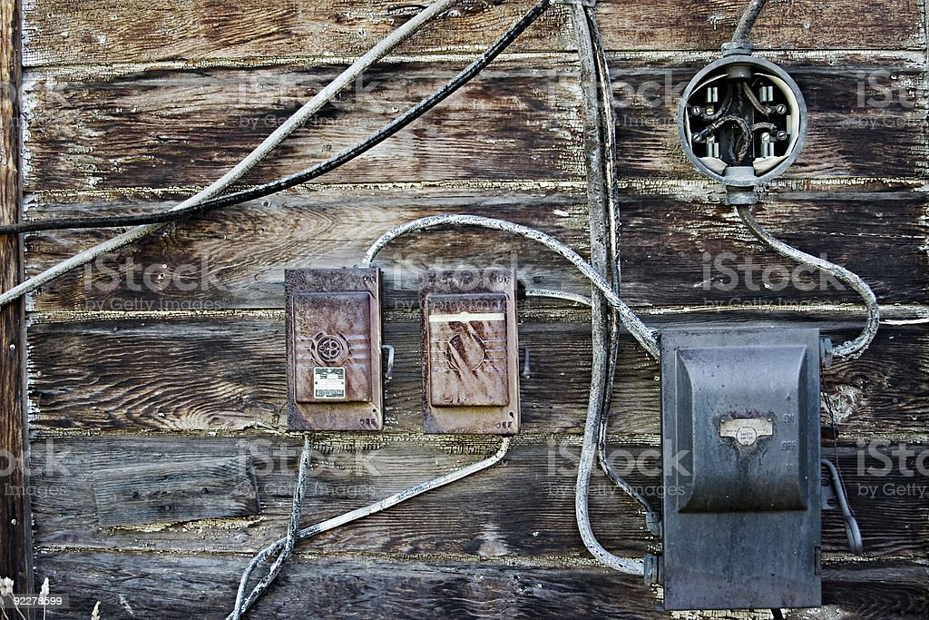 Old Electrical boxes on weathered wood. royalty-free stock photo