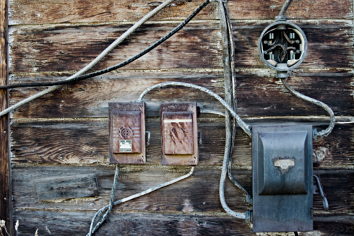 Old Electrical boxes on weathered wood.