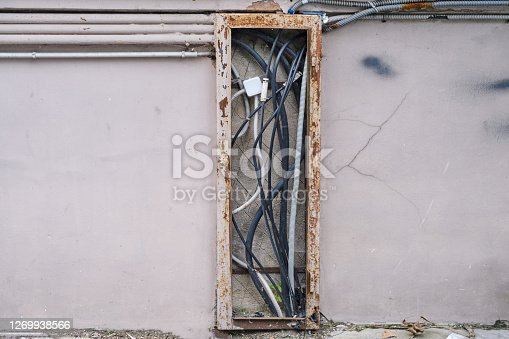 Old electrical wiring on the front of the building