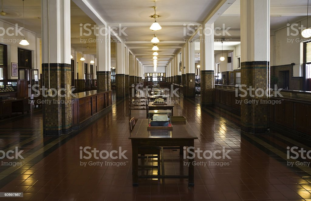 Old, elegant interior of a dark wooded colonial bank stock photo