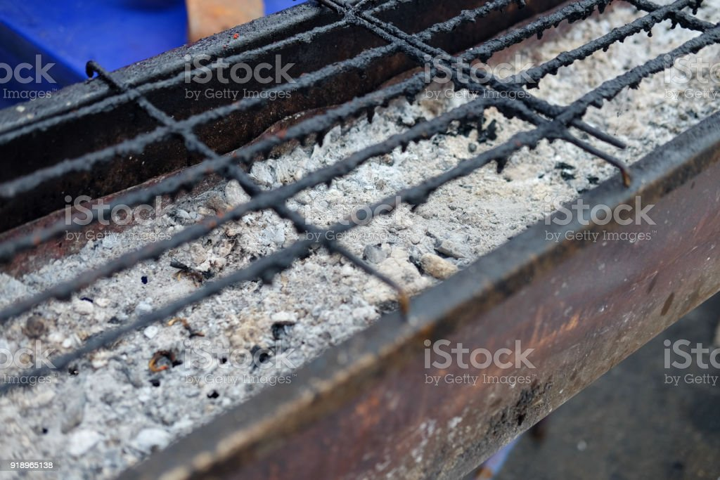 Old empty black grill grid ready for grilling meat in the camping site stock photo