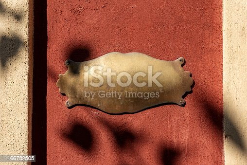 1058533662 istock photo Old empty brass plaque with copy space 1166782505