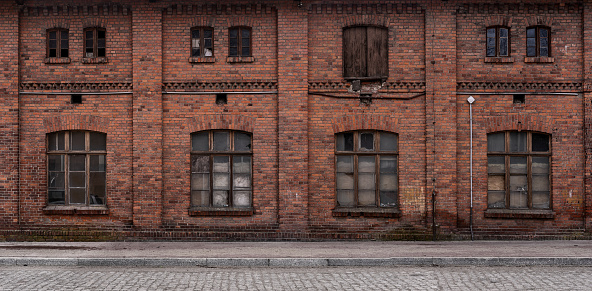istock Old, empty industrial background 1134680342