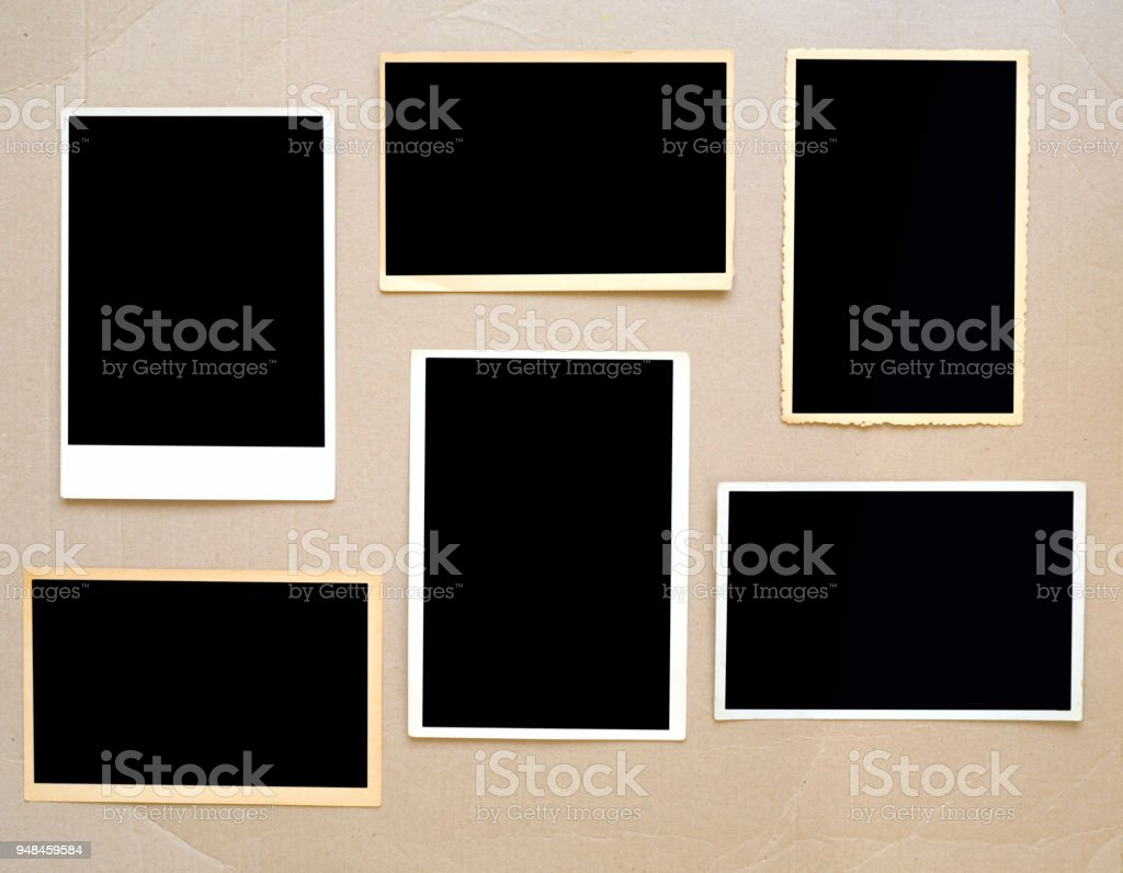 old empty photo frames, vintage photo prints on cardboard with free pics space stock photo