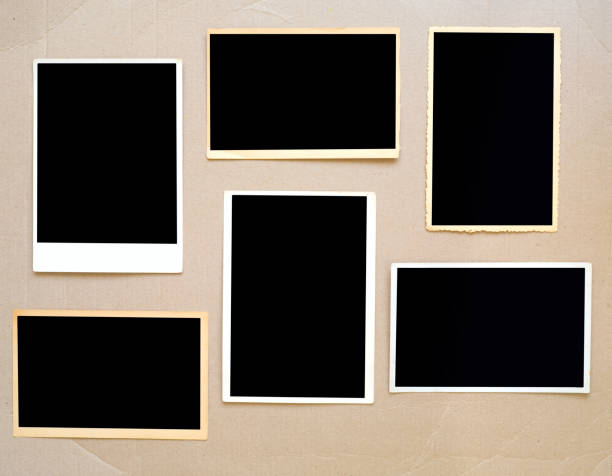 old empty photo frames, vintage photo prints on cardboard with free pics space - photograph stock photos and pictures