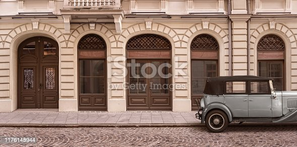 Old empty street background and a retro car with copy space