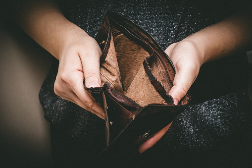 istock Old empty wallet in the hands .Vintage empty purse in hands of women . Poverty concept, Retirement. Special toning 867124970